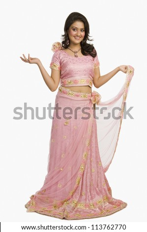 Portrait of a beautiful woman posing in traditional dress - stock photo