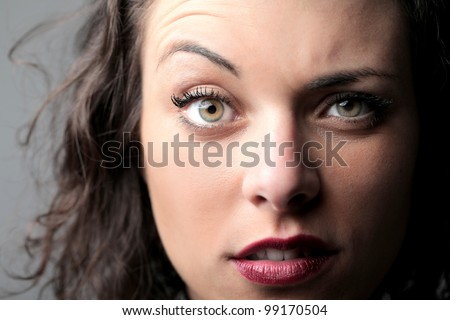 Portrait of a beautiful woman raising an eyebrow - stock photo
