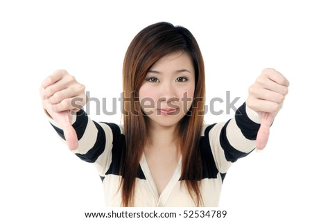 Portrait of a beautiful woman showing thumbs down sign over white background. - stock photo