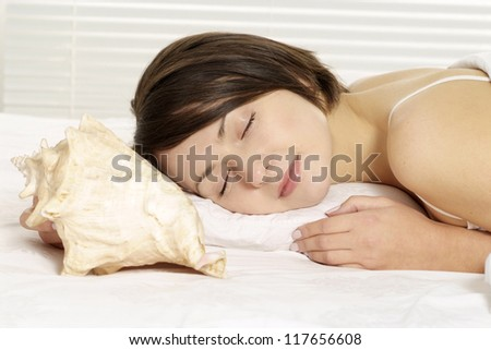 portrait of a beautiful woman sleeping in bed