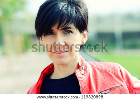 Portrait of a beautiful woman smiling in urban background