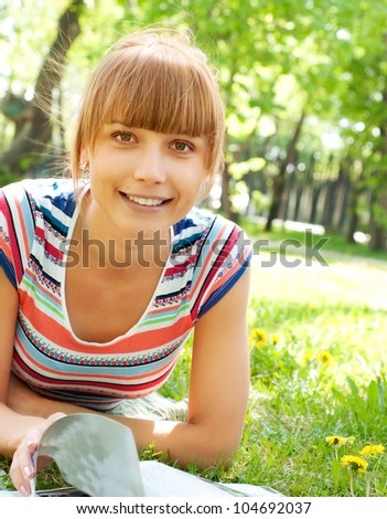 portrait of a beautiful woman, spending time in a summer park