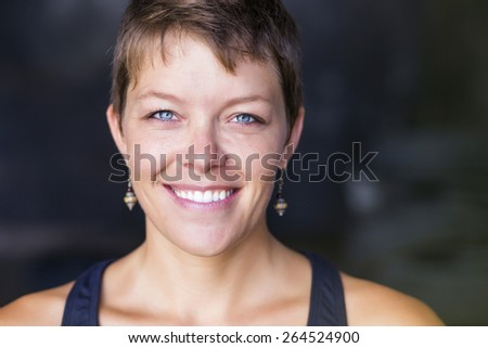 Portrait of a beautiful woman staring at the camera - stock photo