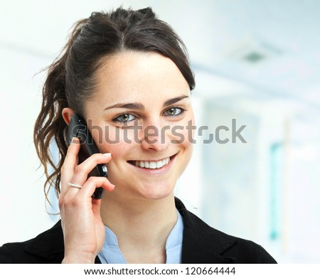Portrait of a beautiful woman talking at phone - stock photo