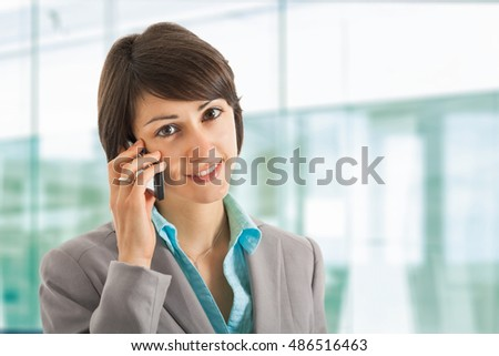 Portrait of a beautiful woman talking on the phone