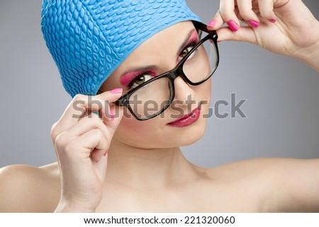 Portrait of a beautiful woman wearing a swim cap - stock photo