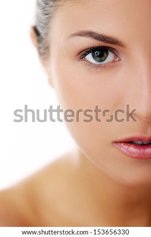 Portrait of a beautiful woman who is posing happily and tenderly over a white background