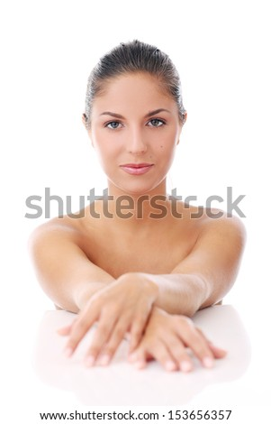 Portrait of a beautiful woman who is posing over a white background