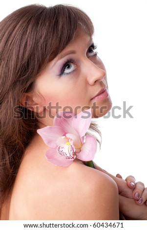 Portrait of a beautiful woman with a flower on a white background.
