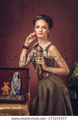 Portrait of a beautiful woman with a handmade doll