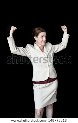 Portrait of a beautiful woman with a nice smile flexing her biceps. - stock photo