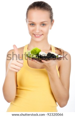 portrait of a beautiful woman with a plate of vegetable salad, Greek salad, vegetarian food, a nice gesture, friendly gesture, a raised finger