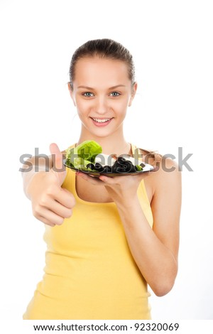 portrait of a beautiful woman with a plate of vegetable salad, Greek salad, vegetarian food, a nice gesture, friendly gesture, a raised finger - stock photo