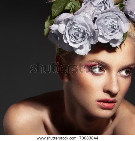 portrait of a beautiful woman with a rose on a dark background
