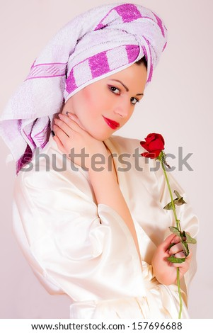 portrait of a beautiful woman with a towel - stock photo