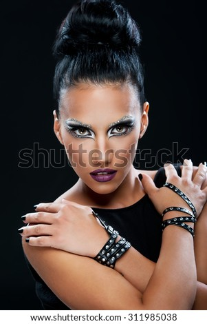 Portrait of a beautiful woman with an amazing make up - stock photo