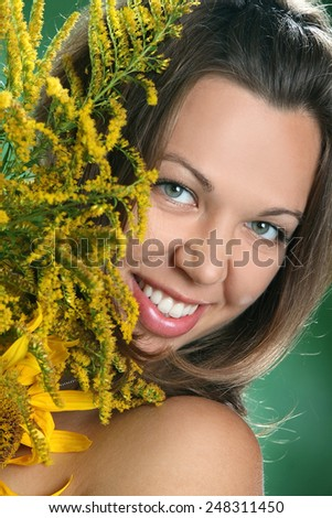 portrait of a beautiful woman with autumn bouquet. beautiful sunflowers. bright emotions, beautiful smile