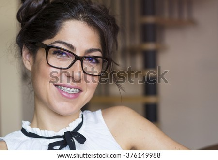 Portrait of a beautiful woman with braces on teeth.Orthodontic Treatment. Dental care Concept - stock photo