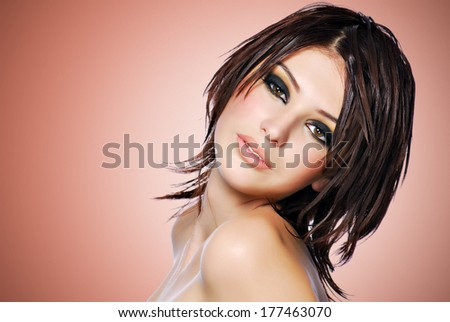 Portrait of a beautiful woman with creative hairstyle. Pretty female model  with fashion makeup  - stock photo