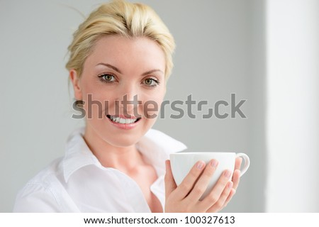 Portrait of a beautiful woman with cup