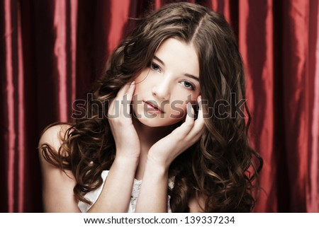 Portrait of a beautiful woman with  curly hairs - stock photo