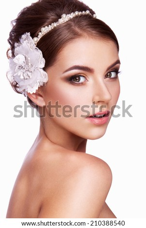 Portrait of a beautiful woman with flowers in her hair. Bride. - stock photo