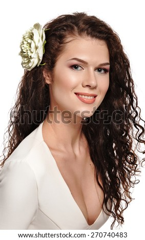 Portrait of a beautiful woman with flowers in her hair. Smiling bride.