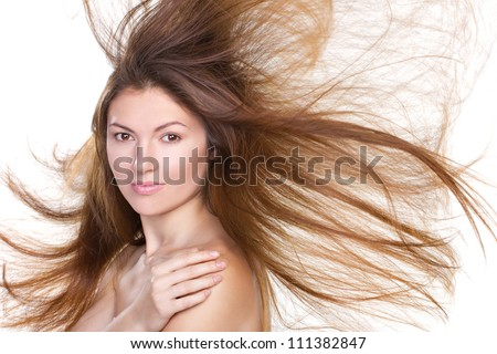 portrait of a beautiful woman with flying hair