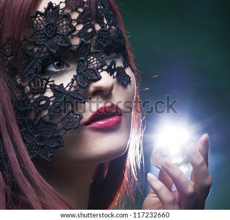 portrait of a beautiful woman with lace mask and  diamond - stock photo