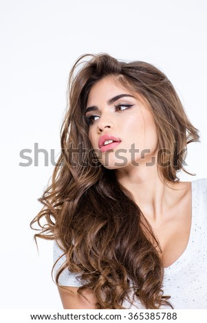 Portrait of a beautiful woman with long curly hair posing isolated on a white background - stock photo