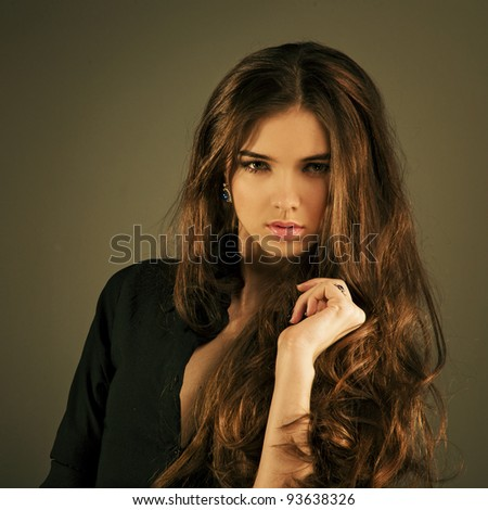 portrait of a beautiful woman with long hair in jewelry
