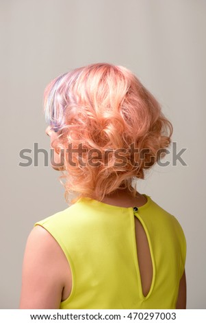 Portrait of a beautiful woman with multi coloured strand in hair, professional hair colouring