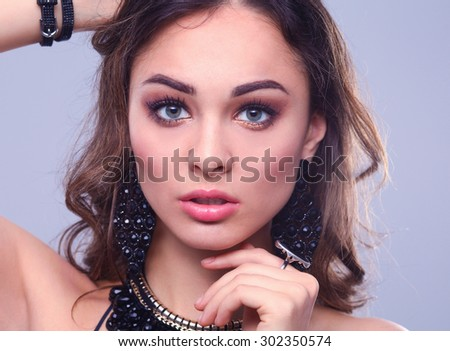 Portrait of a beautiful woman with necklace . - stock photo