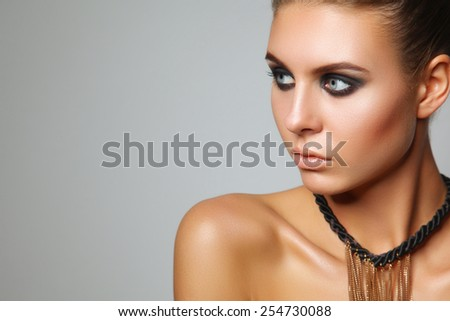Portrait of a beautiful woman with necklace, isolated on white background - stock photo