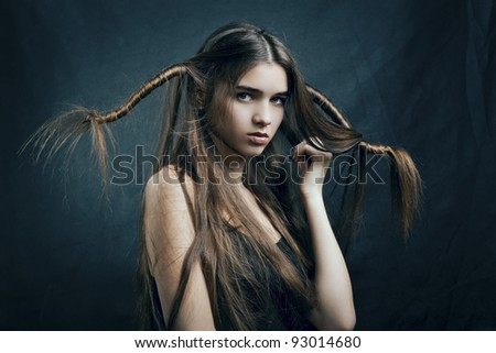 portrait of a beautiful woman with perfect hair on a dark background