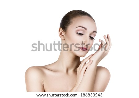 Portrait of a beautiful woman with perfect skin, isolated ob a white background
