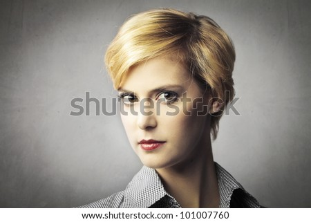 Portrait of a beautiful woman with short hair - stock photo