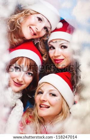 Portrait of a beautiful women wearing a santa hat smiling - stock photo