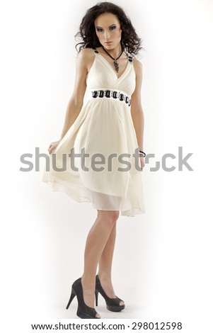 portrait of a beautiful young adult attractive sensuality pretty brunette woman in white elegance dress on white background - stock photo