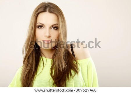 Portrait of a beautiful young adult attractive sexy and sensuality pretty brunette woman in yellow shirt isolated on white background  - stock photo