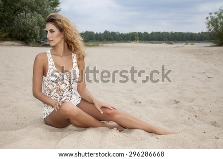 Portrait of a beautiful young adult attractive sexy and sensuality pretty brunette woman wearing white blouse shirt on the beach - stock photo
