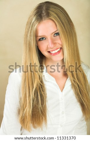 Portrait of a beautiful young adult Caucasian woman with light skin and straight blond hair, green eyes and red lips, wearing a white shirt