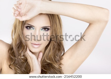 portrait of a beautiful young adult sensuality brunette woman in multicolor makeup isolated on white background  - stock photo