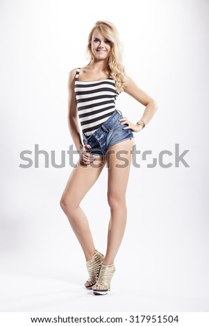 Portrait of a beautiful young adult slim sexy and attractive sensuality pretty blonde woman in elegance fashionable dress isolated on white background - stock photo