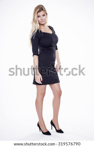 Portrait of a beautiful young adult slim sexy and attractive sensuality pretty blonde woman in black elegance fashionable dress isolated on white background