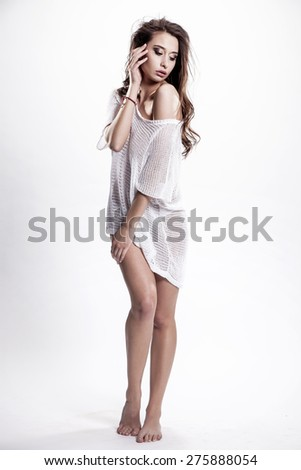 Portrait of a beautiful young adult slim sexy and attractive sensuality pretty brunette woman in white elegance fashionable dress sweater isolated on white background - stock photo