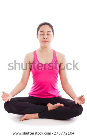 Portrait of a beautiful young asian (thai) woman practicing yoga, sitting in a lotus position isolated on white background - stock photo