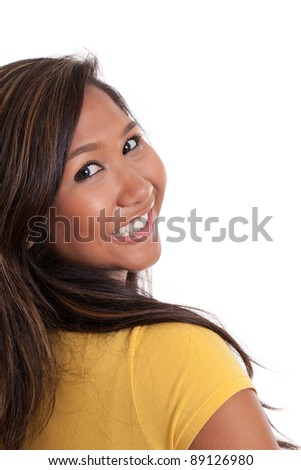 Portrait of a beautiful young Asian woman looking over her shoulder isolated on white - stock photo