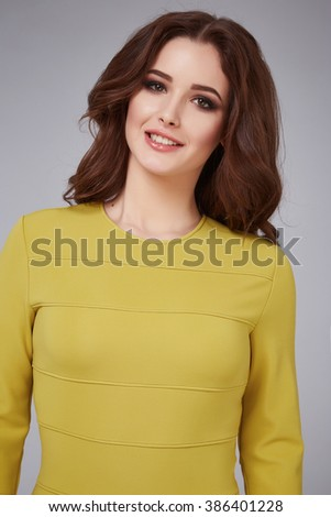 Portrait of a beautiful young attractive woman wearing light silk dress blouse long neck hair brunette, makeup natural, stylish trendy clothing brand, silk collection, face cream, cosmetic, soft skin - stock photo
