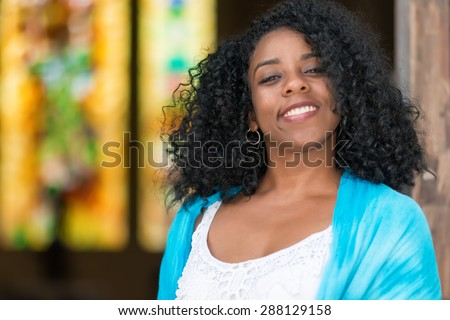 Portrait of a beautiful young black cuban woman smiling - stock photo